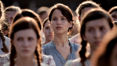 In The Hunger Games, Katniss Everdeen (Jennifer Lawrence) volunteers to take her little sister's place in a killing ritual televised to the masses. </